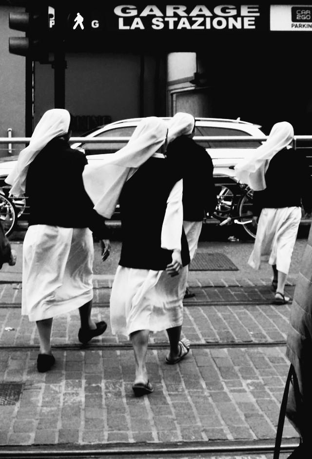 #blackandwhite #streetphotography #people #nuns #inmotion